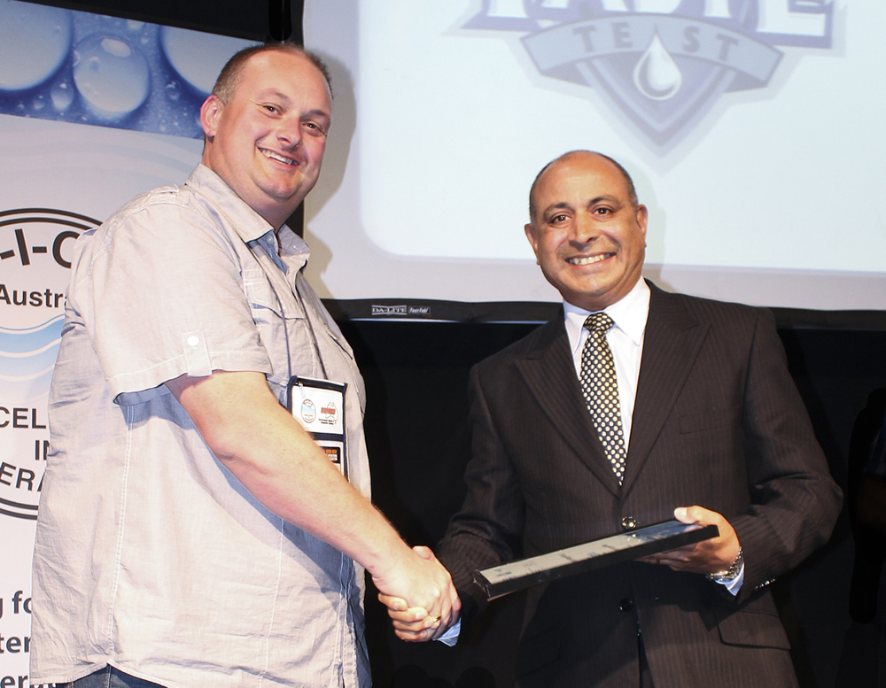 Council's Alan Butler accepts the award from Orica's Herman D'Souza
