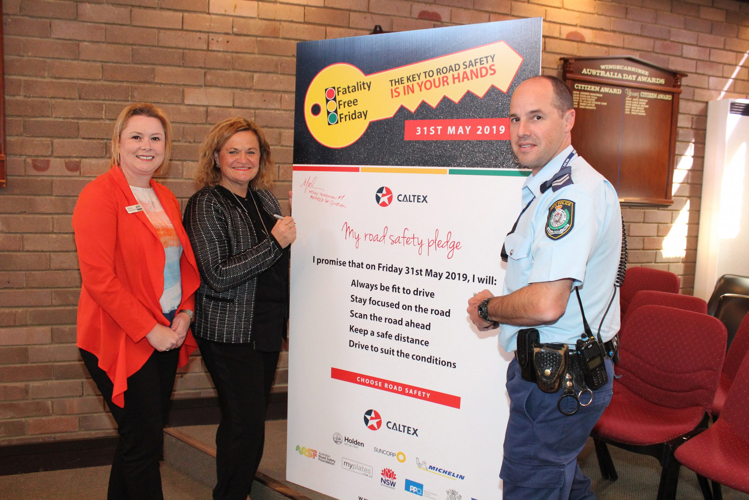 Council's Road Safety Officer, Member for Goulburn Wendy Tuckerman and Senior Constable Scott Waples from the Southern Highlands Highway Patrol take the Fatality Free Friday pledge.