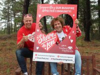 Steve Rosa and Leo Sayer outdoors with campaign material
