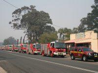 Firetrucks lined up on smokey street