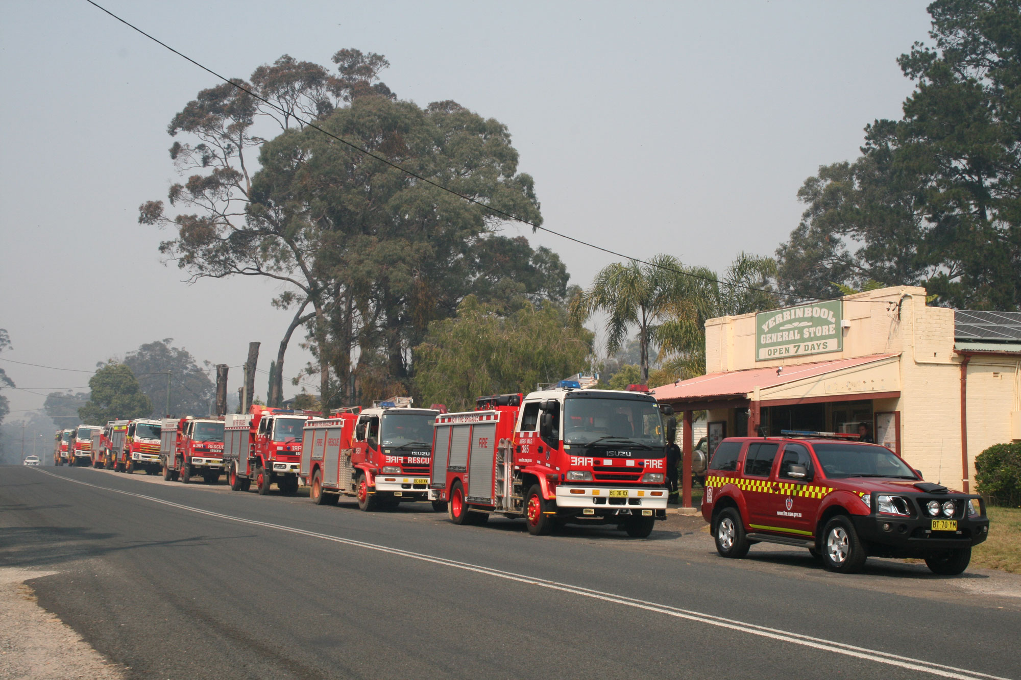 Firetrucks lined up on smokey street