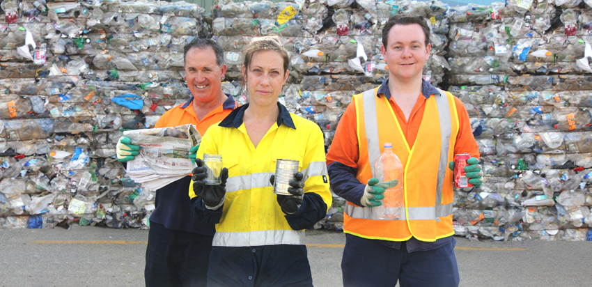 People holding up items of what can be recycled: paper and cardboard, steel and aluminium cans, glass bottles and jars, plastic bottles and containers.