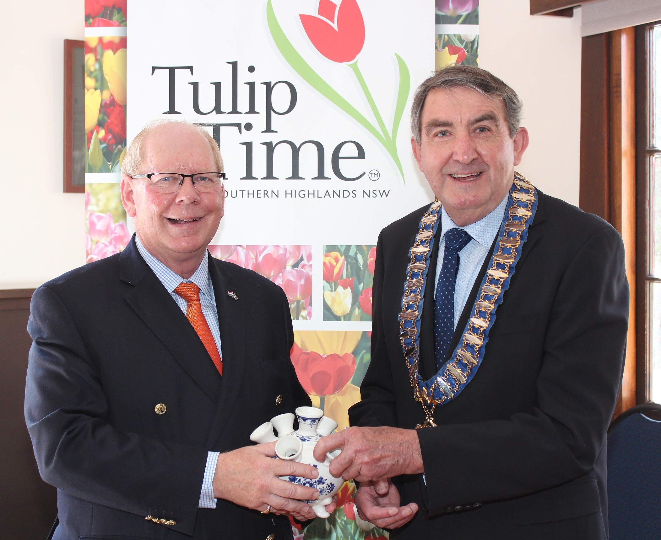 Mr Neuhaus presented Mayor Gair with a porcelain tulip vase from Holland