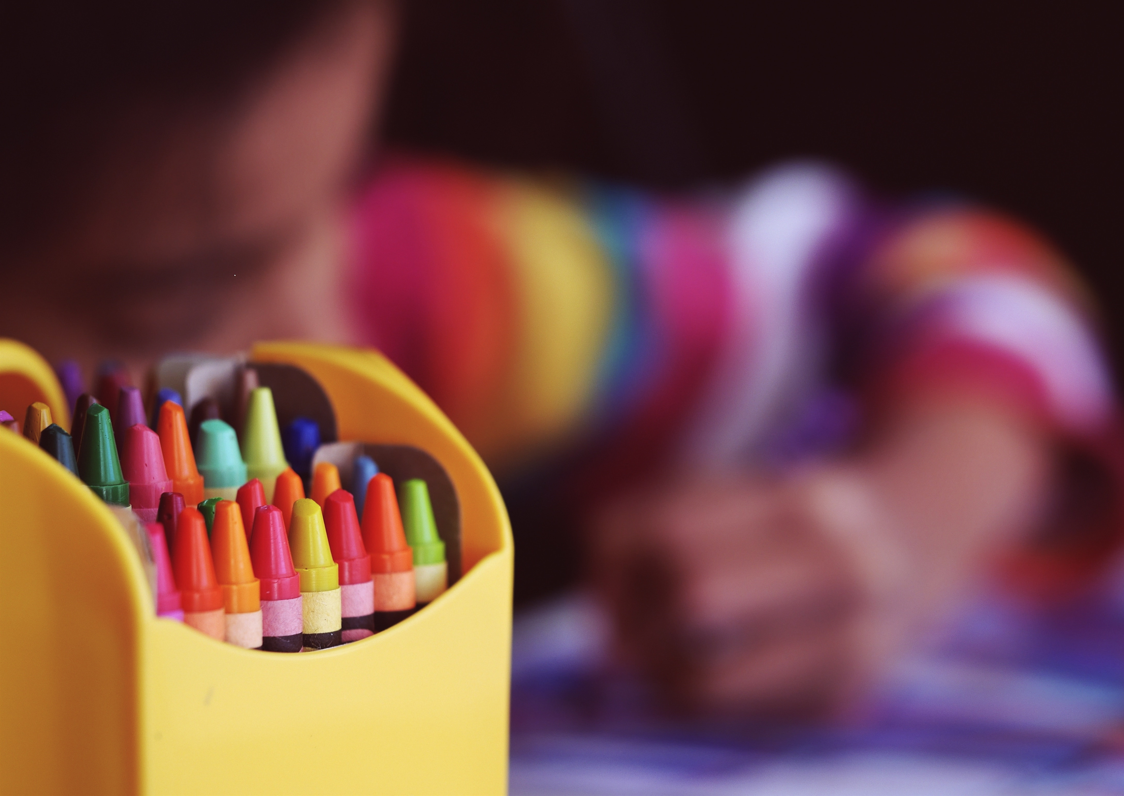 Colouring crayons and child drawing