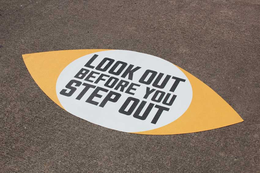 Look before you step out stencil on pavement